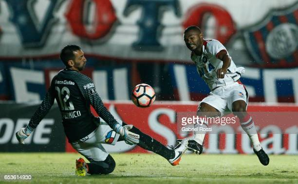 Nikao of Atletico Paranaense kicks the ball during a group stage match between San Lorenzo and Atletico Paranaense as part of Copa CONMEBOL...