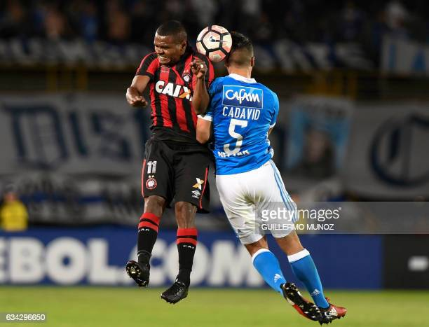 Nikao of Brazil's Atletico Paranaense vies for the ball with Andres Felipe Cadavid from Colombia's Millonarios during a Libertadores Cup football...