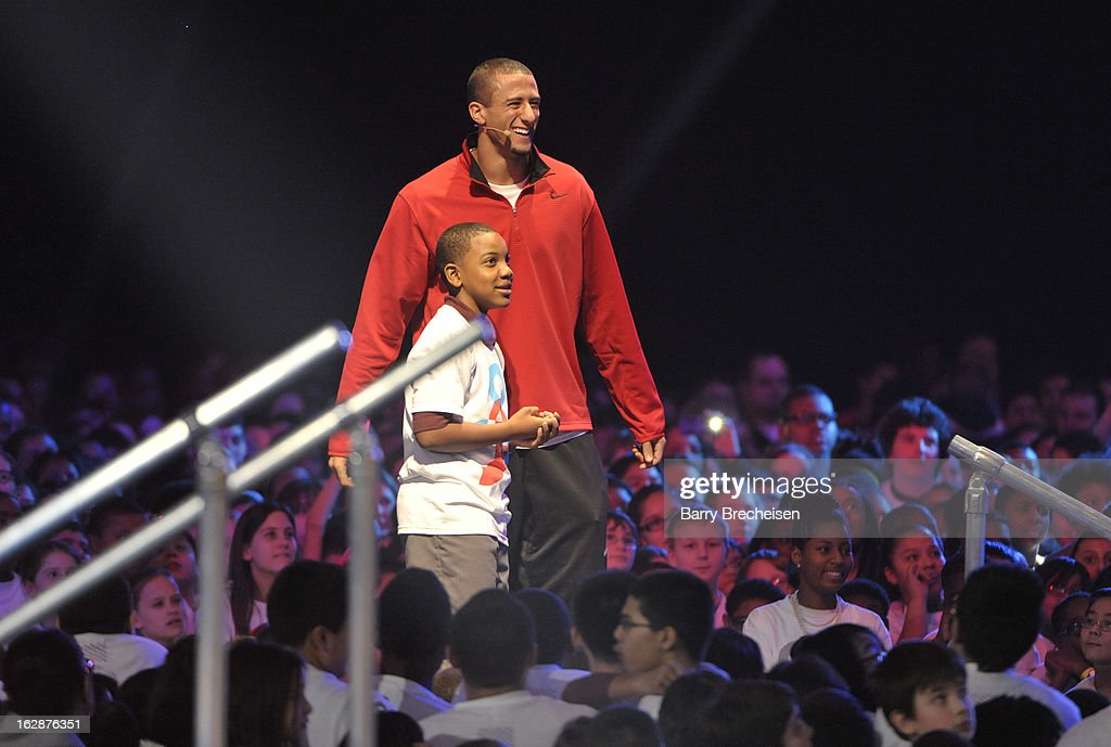 Nike athlete Colin Kaepernick and one of the local Chicago school kids attend the unveiling of a new initiative called 'Let's Move Active Schools' to help schools create a physical activity programs for students at McCormick Place on February 28, 2013 in Chicago, Illinois.