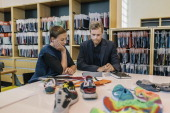 Nike CEO Mark Parker is photographed meeting with Vice President of Sustainable Development Hannah Jones to go over shoe fabrics for Wall Street...