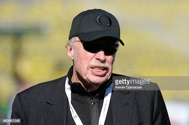 Nike chairman Phil Knight walks on the field prior to the College Football Playoff Semifinal at the Rose Bowl Game presented by Northwestern Mutual...