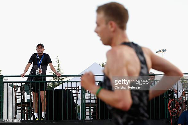 Nike Oregon Project coach Alberto Salazar watches as Galen Rupp competes in the Men's 10000 meter run during day one of the 2015 USA Outdoor Track...