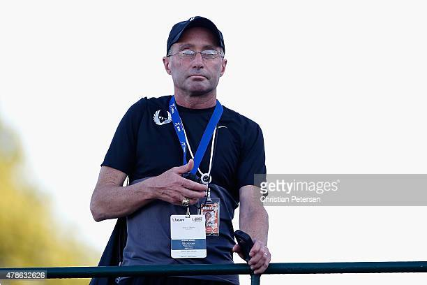 Nike Oregon Project coach Alberto Salazar watches the Men's 10000 meter run during day one of the 2015 USA Outdoor Track Field Championships at...