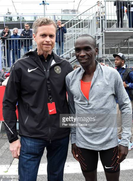 Nike President and CEO Mark Parker poses with Eliud Kipchoge on the finish area during the Nike Breaking2 SubTwo Marathon Attempt at Autodromo di...