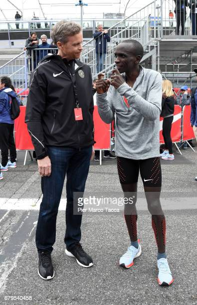Nike President and CEO Mark Parker speaks with Eliud Kipchoge at on the arrive during the Nike Breaking2 SubTwo Marathon Attempt at Autodromo di...