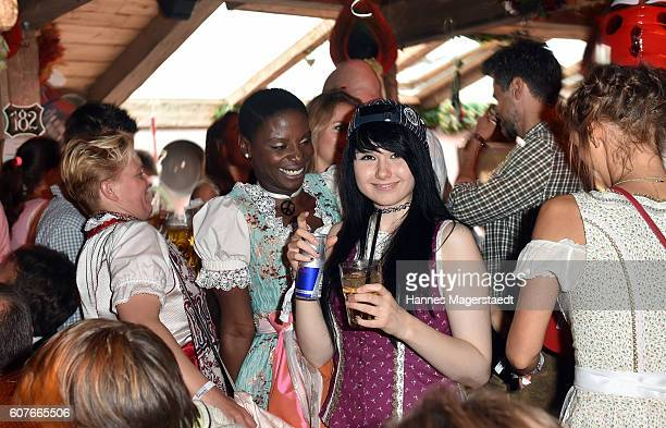 Nikeata Thompson and JamieLee Kriewitz during the ProSieben Sat1 Wiesn as part of the Oktoberfest 2016 at Kaefer Tent on September 18 2016 in Munich...