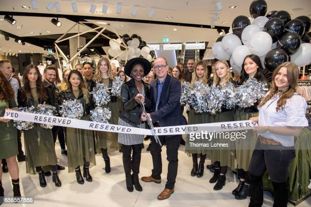 Nikeata Thompson and Martin Kanngiesser Managing Director Reserverd Germany cutting the ribbon during the RESERVED store opening on March 22 2017 in...