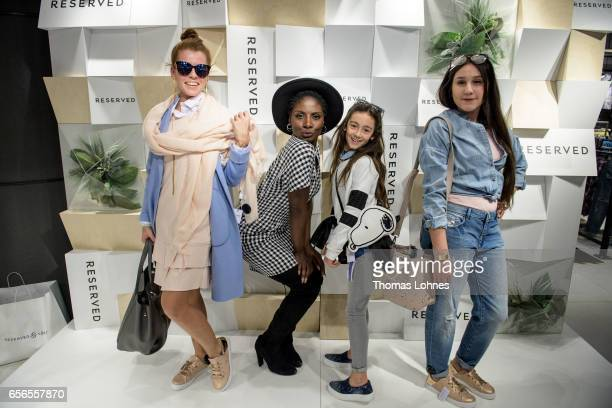 Nikeata Thompson with kids during styling competion at the RESERVED store opening on March 22 2017 in Cologne Germany