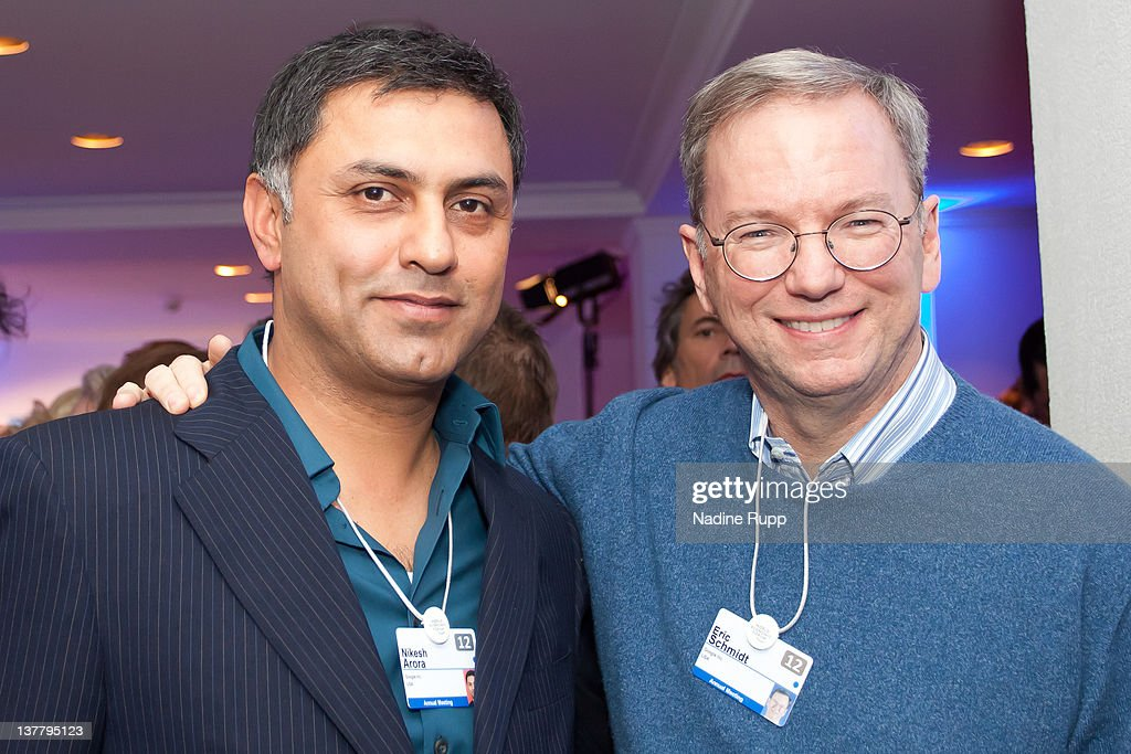 Nikesh Arora of Google and Executive Chairman of Google Inc. <a gi-track='captionPersonalityLinkClicked' href=/galleries/search?phrase=Eric+Schmidt&family=editorial&specificpeople=5515021 ng-click='$event.stopPropagation()'>Eric Schmidt</a> attend the Burda DLD Nightcap 2011 at the Steigenberger Belvedere hotel on January 25, 2012 in Davos, Switzerland. DLD (Digital - Life - Design) is a global conference network on innovation, digital, science and culture which connects business, creative and social leaders, opinion-form science and culture which connects business, creative and social leaders, opinion-formers and investors for crossover conversation and inspiration.