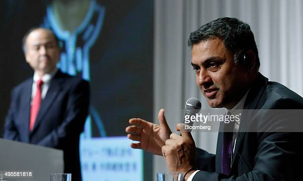 Nikesh Arora president and chief operating officer of SoftBank Group Corp right speaks as billionaire Masayoshi Son chairman and chief executive...