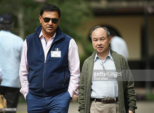 Nikesh Arora president chief operating officer of SoftBank Corpchats with Masayoshi Son founder and chief executive officer of SoftBank the chief...