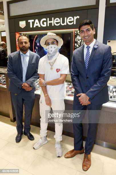 Nikhil Bhindi Ashwin Bhindi and artist Alec Monopoly attend TAG Heuer Connected Watch V2 Popup Store Inauguration at Bhindi's on March 15 2017 in...