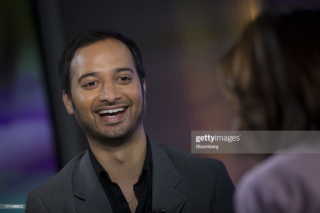 Nikhil Kalghatgi, principal at Softbank Capital, laughs during a Bloomberg Television interview in New York, U.S., on Tuesday, June 25, 2013. Kalghatgi spoke about Snapchat, and app designed for sharing impermanent media. Photographer: Scott Eells/Bloomberg via Getty Images