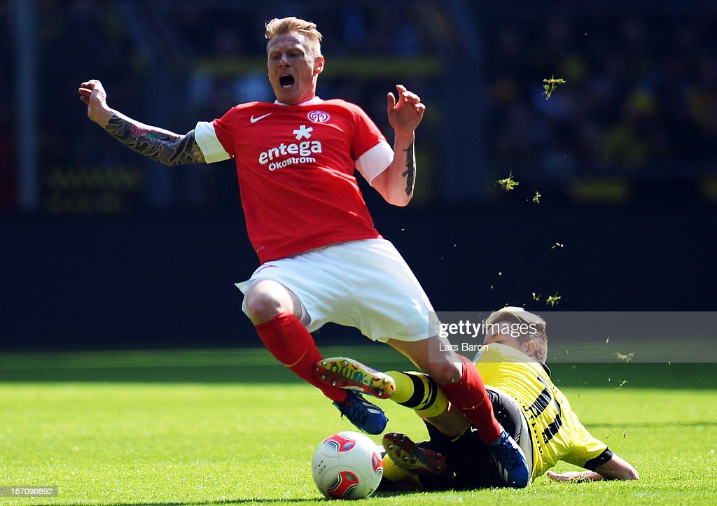 Niki Dige Zimling of Mainz is challenged by <a gi-track='captionPersonalityLinkClicked' href=/galleries/search?phrase=Marco+Reus&family=editorial&specificpeople=5445884 ng-click='$event.stopPropagation()'>Marco Reus</a> of Dortmund during the Bundesliga match between Borussia Dortmund and 1. FSV Mainz 05 at Signal Iduna Park on April 20, 2013 in Dortmund, Germany.