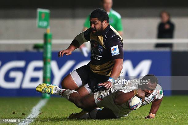 Niki Goneva of Leicester Tigers scores a last minute winning try as Paea Fa'anunu of Montpellier challenges during the Heineken Cup Pool 5 match...