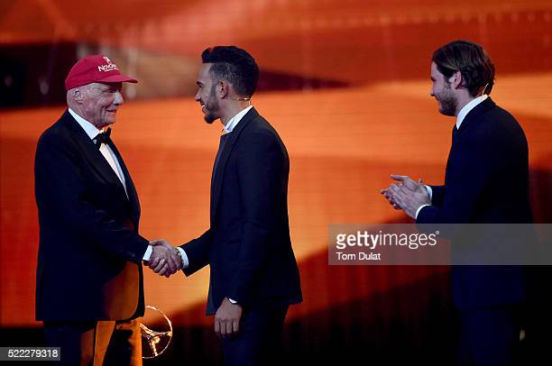 Niki Lauda MercedesBenz Motorsport NonExecutive Chairman with his Laureus Lifetime Achievement Award shakes the hand of Formula 1 driver Lewis...