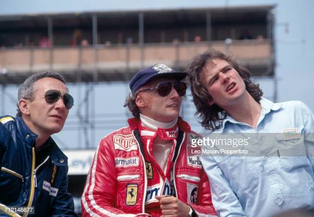 Niki Lauda of Austria who finished second driving a Ferrari 312T2 with a Ferrari 015 30 F12 engine for Team Scuderia Ferrari SpA SEFAC talking to...