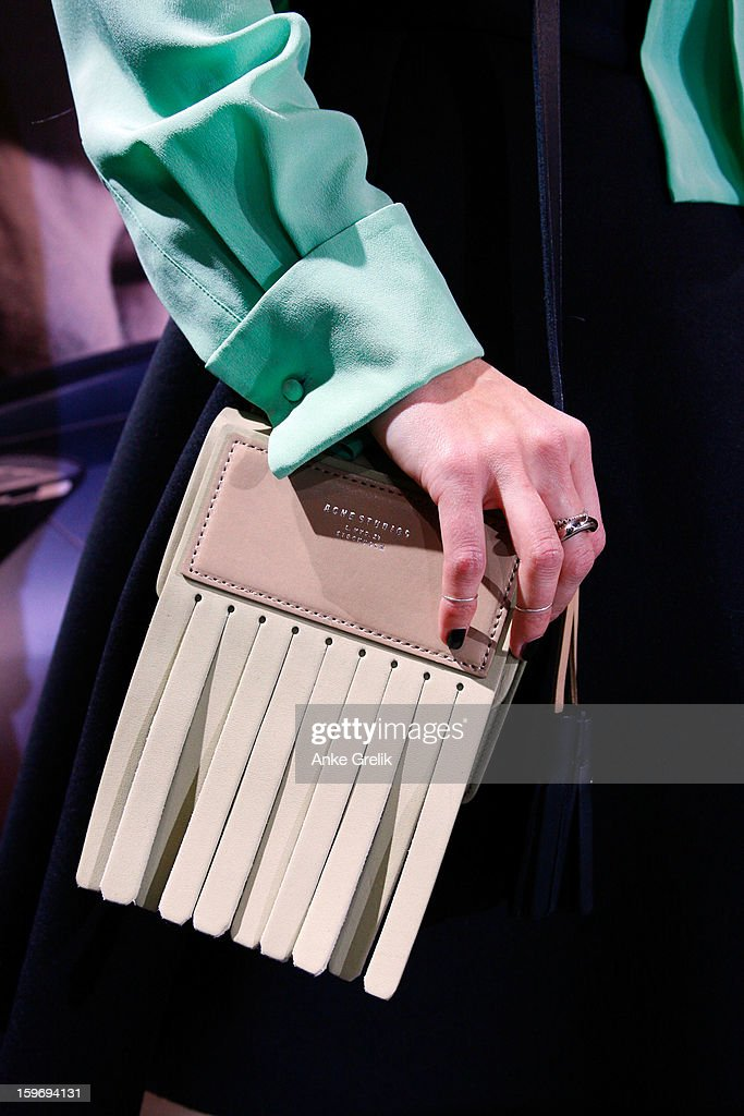 Niki Pauls carrying an Acne bag attends Mercedes-Benz Fashion Week Autumn/Winter 2013/14 at the Brandenburg Gate on January 18, 2013 in Berlin, Germany.