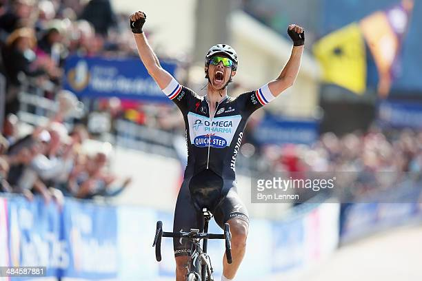 Niki Terpstra of the Netherlands and Omega Pharma QuickStep celebrates winning the 112th edition of the Paris Roubaix cycle race from Compiegne to...