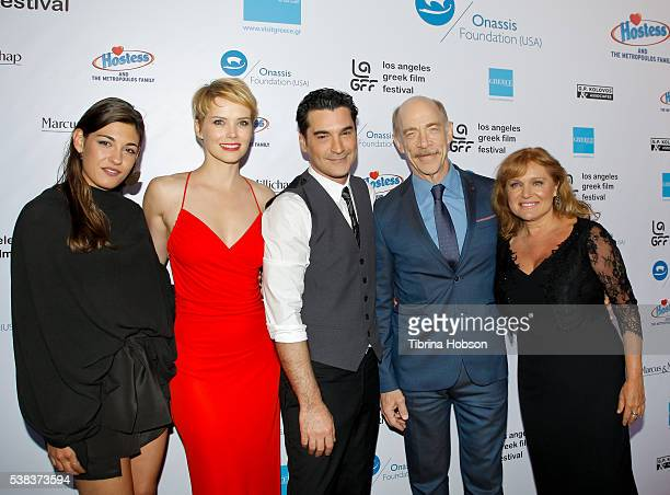 Niki Vakali Andrea Osvart Christopher Papakaliatis JK Simmons and Maria Kavoyianni attend the premiere of 'Worlds Apart' at the Egyptian Theatre on...