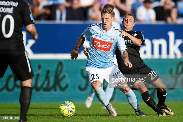Niki Zimling of SonderjyskE and Joel Allansson of Randers FC compete for the ball during the Danish Alka Superliga match between SonderjyskE and...