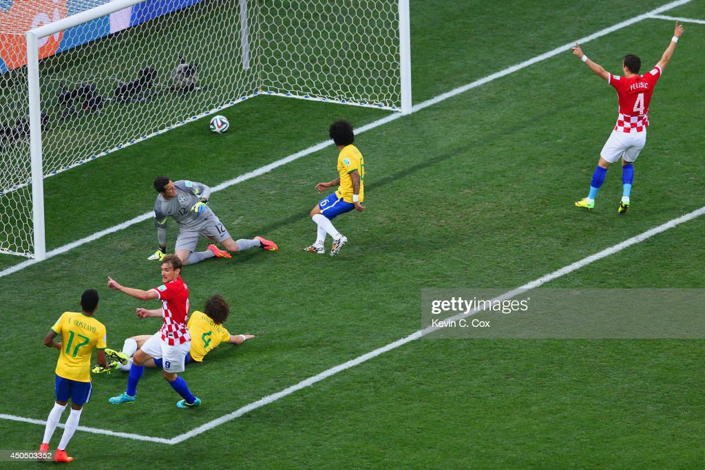 Nikica Jelavic and Ivan Perisic of Croatia celebrate as Julio Cesar David Luiz and Marcelo of Brazil watch a deflected shot cross the goal line...