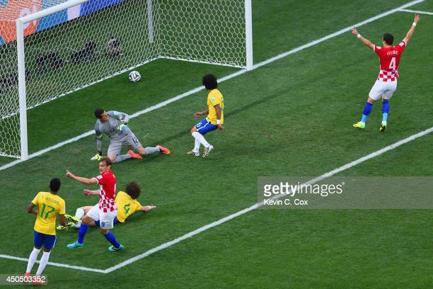 Nikica Jelavic and Ivan Perisic of Croatia celebrate as Julio Cesar David Luiz and Marcelo of Brazil watch a deflected shot cross the goal line...