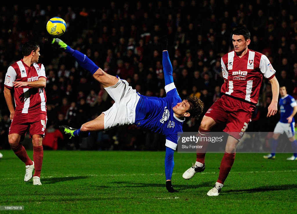 Nikica Jelavic of Everton attempts an overhead kick as Billy Jones of Cheltenham Town (R) looks on during the FA Cup with Budweiser Third Round match between Cheltenham Town and Everton at Abbey Business Stadium on January 7, 2013 in Cheltenham, England.