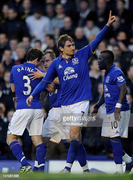 Nikica Jelavic of Everton celebrates scoring the opening goal during the Barclays Premier League match between Everton and Tottenham Hotspur at...