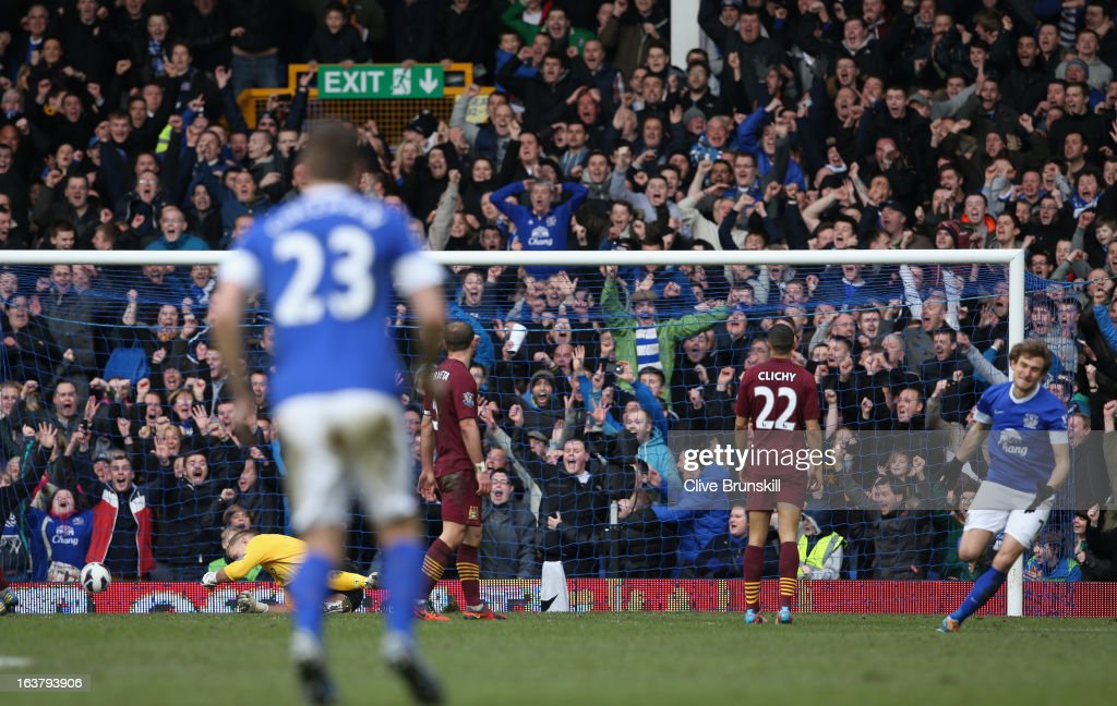 <a gi-track='captionPersonalityLinkClicked' href=/galleries/search?phrase=Nikica+Jelavic&family=editorial&specificpeople=5986831 ng-click='$event.stopPropagation()'>Nikica Jelavic</a> of Everton scores the second goal during the Barclays Premier League match between Everton and Manchester City at Goodison Park on March 16, 2013 in Liverpool, England.