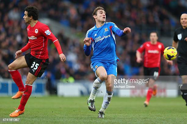 Nikica Jelavic of Hull City challenged by Fabio Da Silva of Cardiff City looks on during the Barclays Premier League match between Cardiff City and...