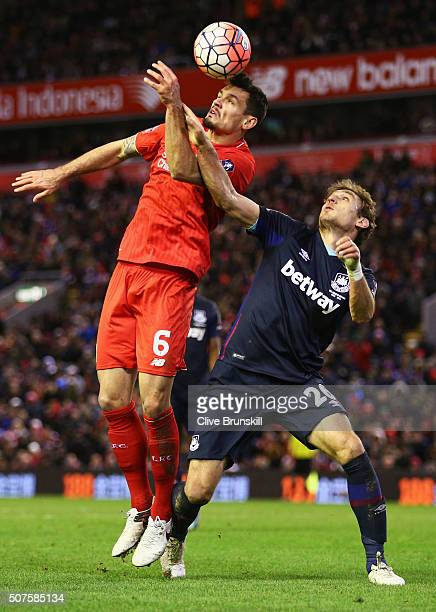 Nikica Jelavic of West Ham United battles with Dejan Lovren of Liverpool during the Emirates FA Cup Fourth Round match between Liverpool and West Ham...
