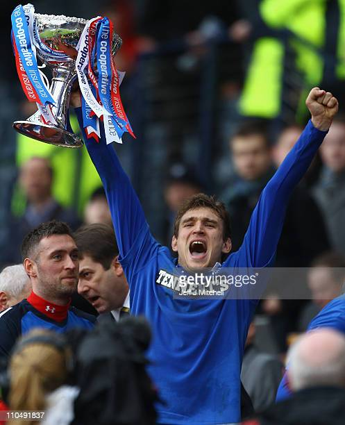 Nikicia Jelavic of Rangers lifts the Cooperative Insurance Cup after beating Celtic in the final at Hampden Park on March 20 2011 in Glasgow Scotland