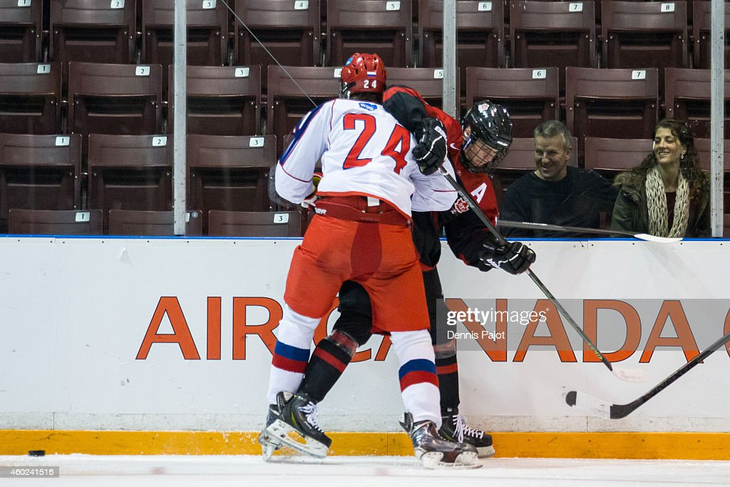 Nikita A. Popugayev #24 of Russia places a hit on Tyler Benson #17 of Canada Black during the World Under-17 Hockey Challenge on November 2, 2014 at the RBC Centre in Sarnia, Ontario.