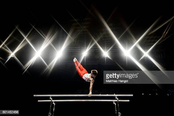 Nikita Ignateyev of MTV Stuttgart competes in the Parallel Bars during the DTL Finals 2015 at Messehalle 2 on December 5 2015 in Karlsruhe Germany