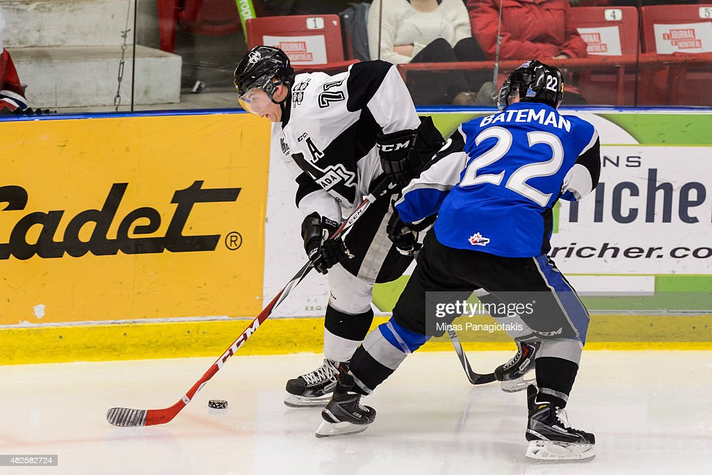 Nikita Jevpalovs #71 of the Blainville-Boisbriand Armada tries to carry the puck with Adam Bateman #22 of the Saint John Sea Dogs close by during the QMJHL game at the Centre Excellence Rousseau on January 31, 2015 in Blainville-Boisbriand, Quebec, Canada. The Blainville-Boisbriand Armada defeated the Saint John Sea Dogs 4-0.
