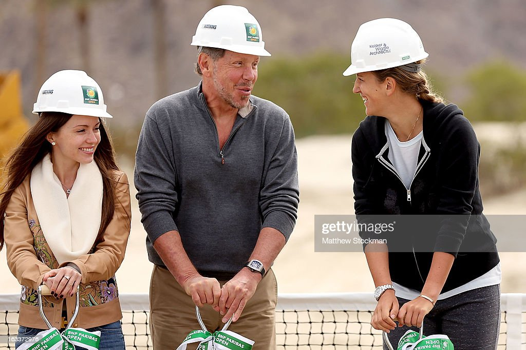 Nikita Kahn and Larry Ellison, tournament owner and CEO of Oracle, chat with Victoria Azarenka of Belarus at the ground breaking ceremony for the Indian Wells Tennis Garden expansion during the BNP Paribas Open at the Indian Wells Tennis Garden on March 8, 2013 in Indian Wells, California.