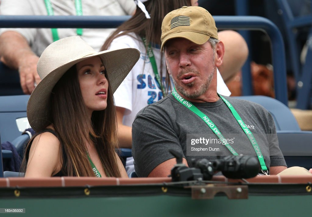 Nikita Kahn and Larry Ellison, tournament owner and CEO of Oracle, attend the match between Roger Federer of Switzerland and Denis Istomin of Uzbekistan during day 4 of the BNP Paribas Open at Indian Wells Tennis Garden on March 9, 2013 in Indian Wells, California.