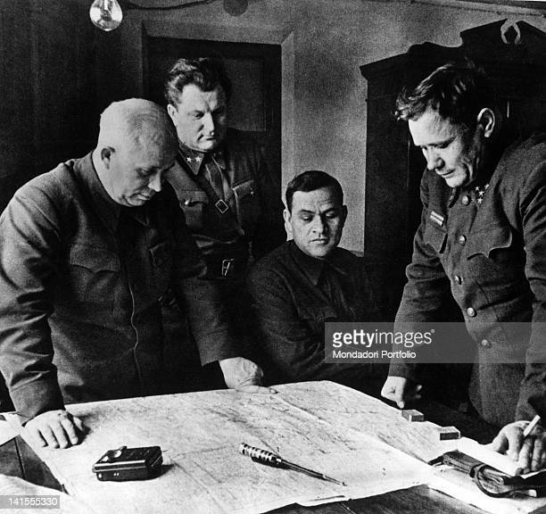 Nikita Khrushchev Andrej Eremenko and other officers studying military strategy during the siege of Stalingrad today Volgograd Stalingrad August 1942