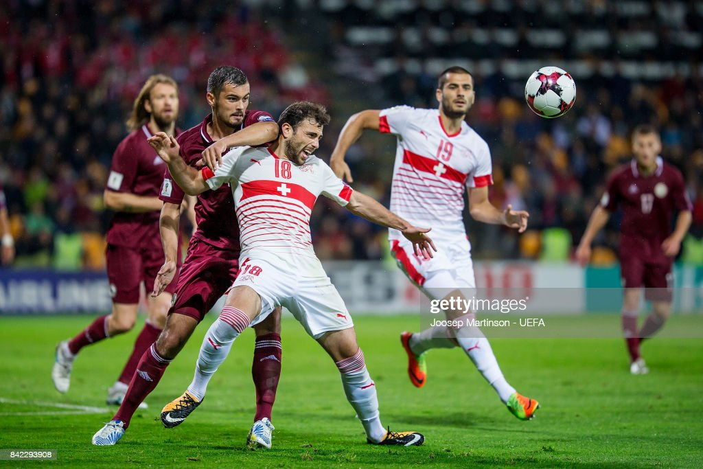 Nikita Kolesovs of Latvia competes with Admir Mehmedi of Switzerland during the FIFA 2018 World Cup Qualifier between Latvia and Switzerland at Skonto Stadium on September 3, 2017 in Riga, Latvia.