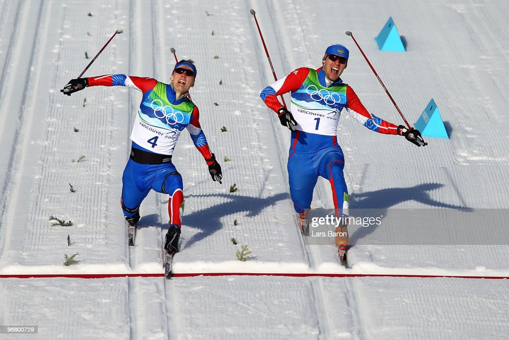 Nikita Kriukov (gold medal winner) and Alexander Panzhinskiy (silver medal winner) of Russia cross the finish line to finish first and second in the Men's Individual Sprint C Final on day 6 of the 2010 Vancouver Winter Olympics at Whistler Olympic Park Biathlon Stadium on February 17, 2010 in Whistler, Canada.