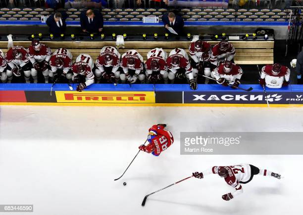 Nikita Kucherov of Russia challenges Oskars Cibulskis of Latvia for the puck during the 2017 IIHF Ice Hockey World Championship game between Russia...