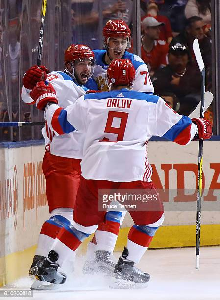 Nikita Kucherov of Team Russia is congratulated by his teammates Dmitry Orlov and Evgeni Malkin after scoring a second period goal against Team...