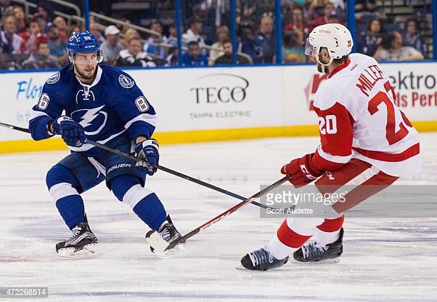 Nikita Kucherov of the Tampa Bay Lightning against Drew Miller of the Detroit Red Wings during the third period of Game Seven of the Eastern...