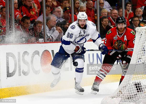 Nikita Kucherov of the Tampa Bay Lightning and Duncan Keith of the Chicago Blackhawks watch the puck during the third period of Game Three of the...