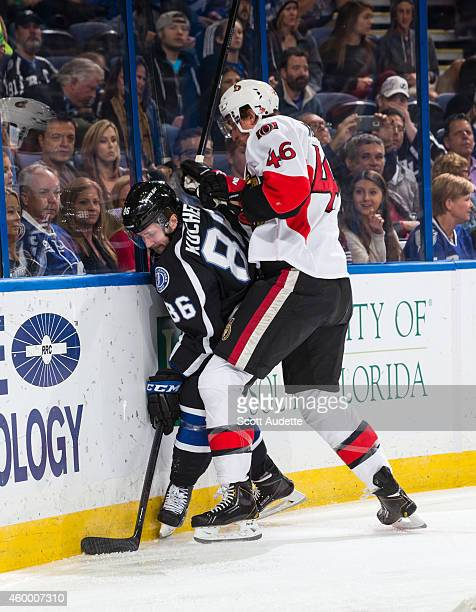 Nikita Kucherov of the Tampa Bay Lightning battles against Patrick Wiercioch of the Ottawa Senators during the first period at the Amalie Arena on...