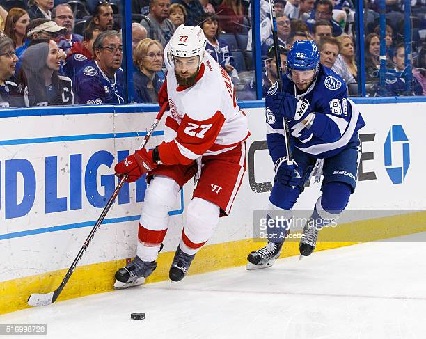 Nikita Kucherov of the Tampa Bay Lightning battles for the puck against Kyle Quincey of the Detroit Red Wings during the first period at the Amalie...