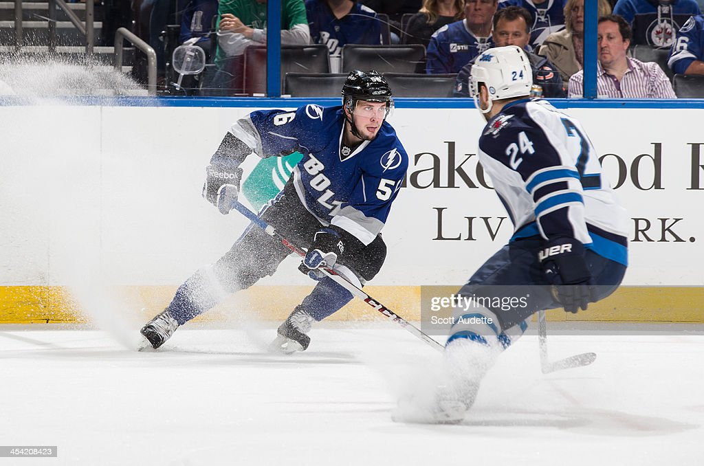Nikita Kucherov of the Tampa Bay Lightning carries the puck against Grant Clitsome of the Winnipeg Jets during the first period at the Tampa Bay...