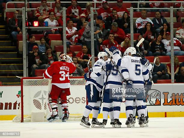 Nikita Kucherov of the Tampa Bay Lightning celebrates a first period goal with teammates in front of Petr Mrazek of the Detroit Red Wings at Joe...