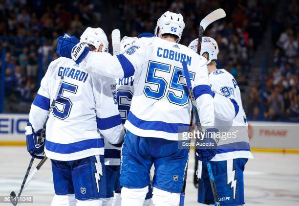 Nikita Kucherov of the Tampa Bay Lightning celebrates a goal with teammates against the St Louis Blues during the third period at Amalie Arena on...